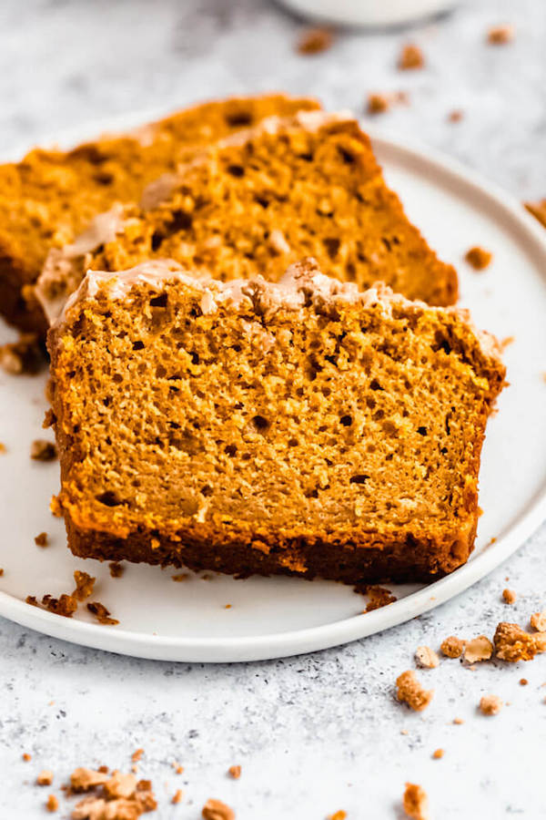 three slices of pumpkin streusel bread on a plate