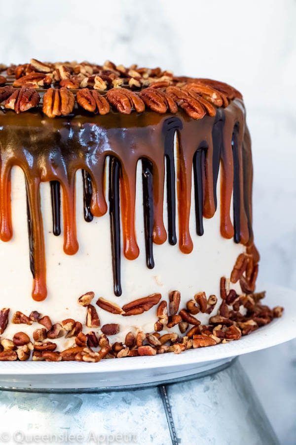 This Turtle Chocolate Layer Cake starts with rich, decadent and moist chocolate cake layers that are filled with a caramel pecan sauce and covered in a smooth caramel frosting, then finished off with a caramel and ganache drip and chopped pecans!