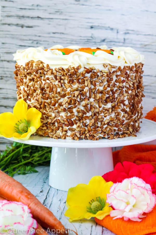 This is the perfect Carrot Cake recipe! Super moist and soft cake made with loads of fresh carrots, all covered in a silky smooth cream cheese frosting and decorated with chopped pecans and adorable cream cheese carrots!