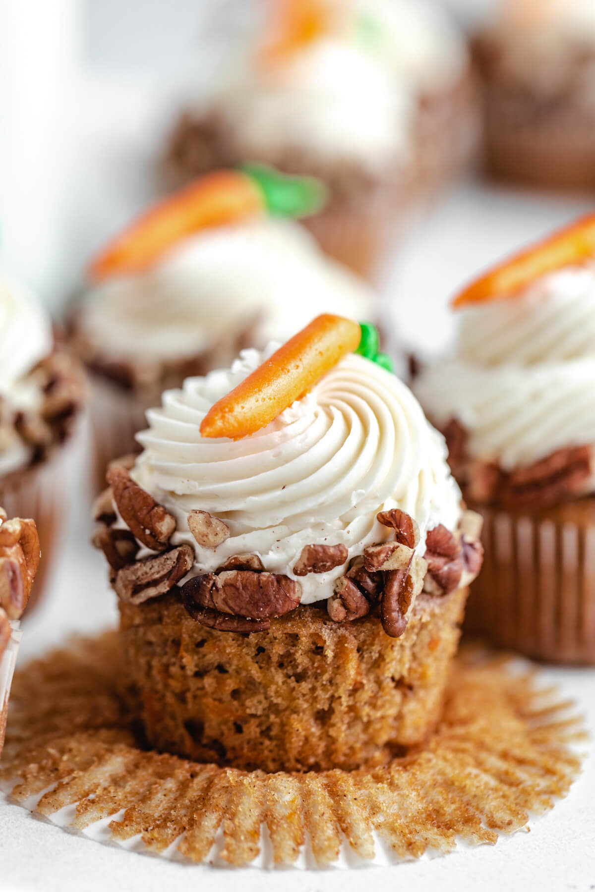 close up of unwrapped carrot cupcake