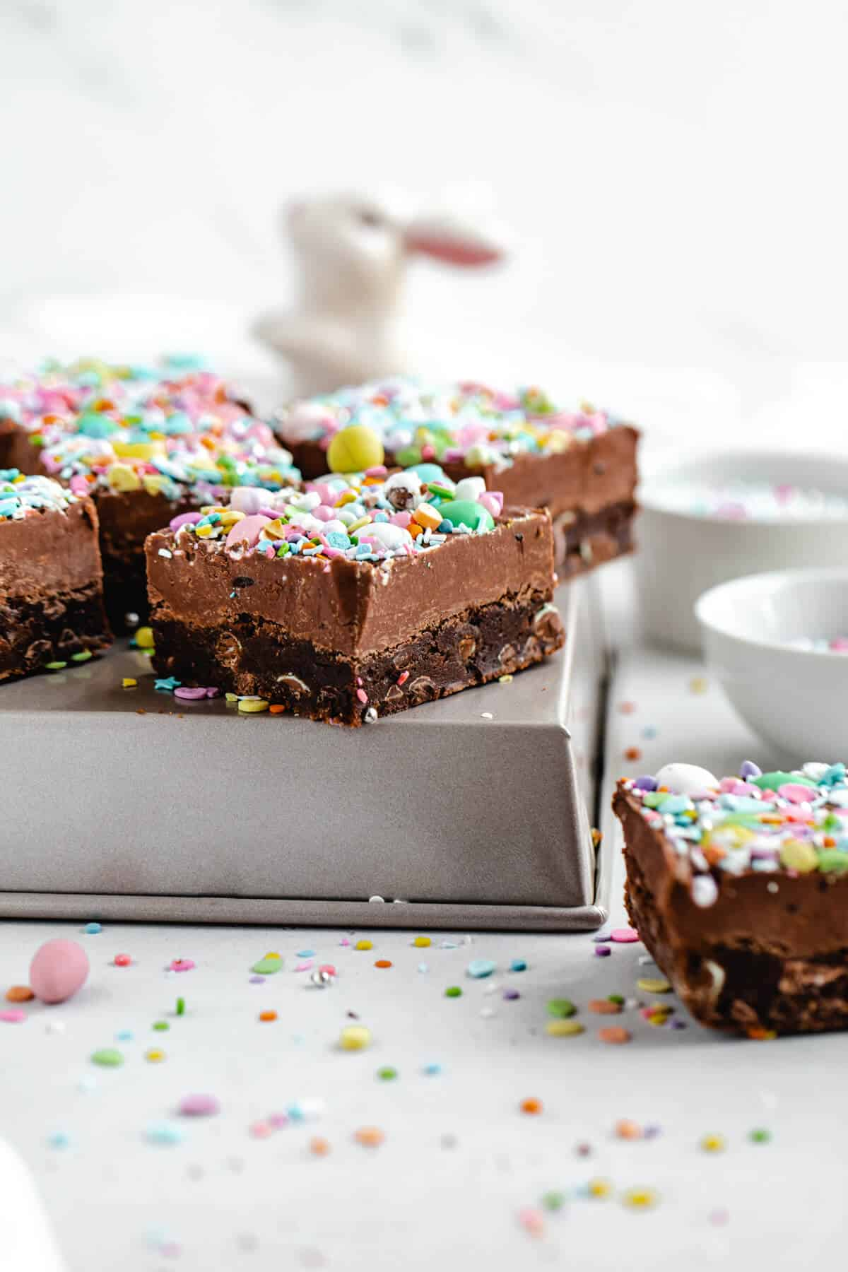 fudge topped brownies on a square cake pan