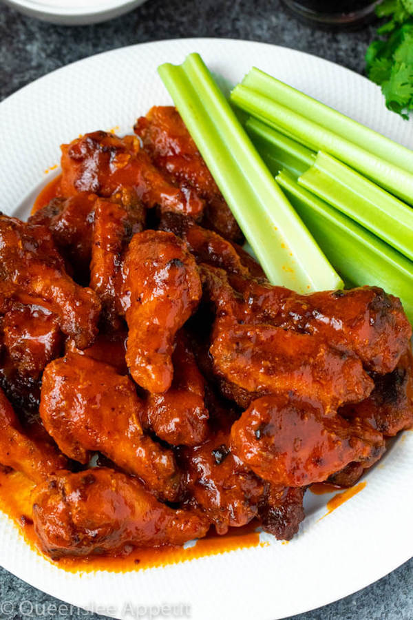 Crispy Baked Buffalo Chicken Wings with celery sticks on the side