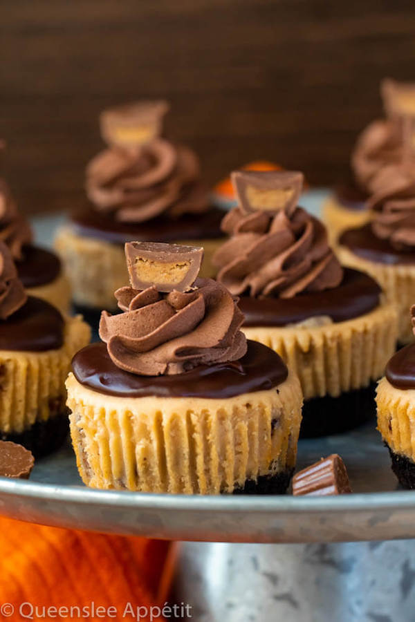 Mini Reese's Peanut Butter Cheesecakes on a cake stand