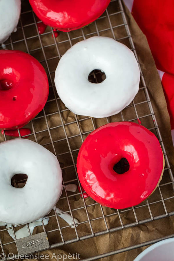 Moist and fluffy baked vanilla donuts dipped in red and white glaze