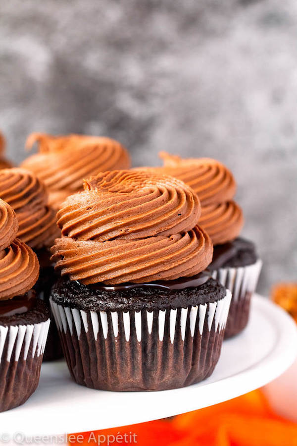 chocolate cupcakes with ganache, chocolate caramel cream cheese frosting on top