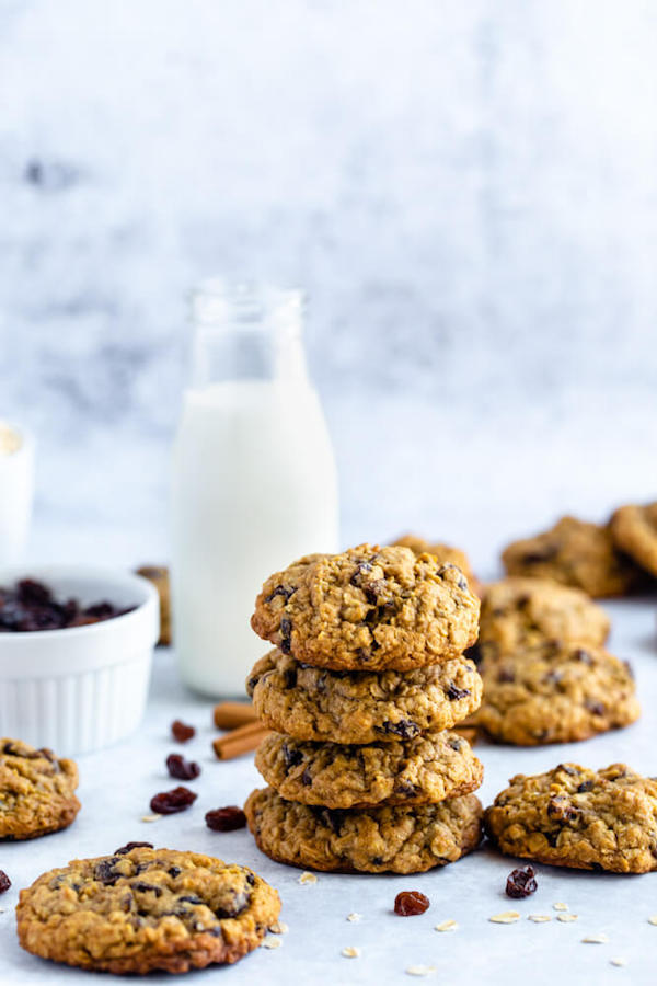 Thick, soft and chewy Oatmeal Raisin Cookies that taste like they came straight out of the bakery! Packed with oats, raisins, cinnamon and molasses — they're just begging to be dunked into a tall glass of cold milk! #cookies #cookierecipes #oatmealcookies #easyrecipe