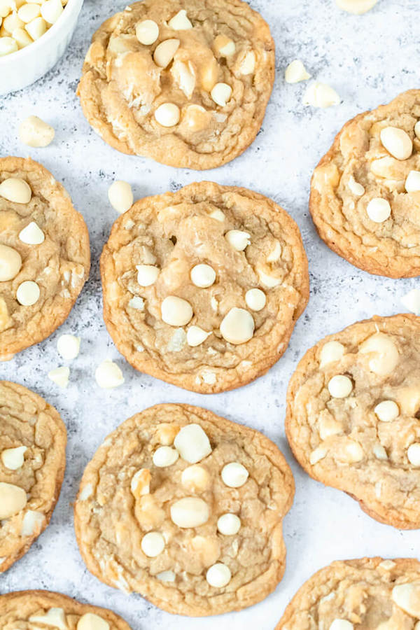 Today is all about the classic White Chocolate Macadamia Nut Cookies! Soft, buttery, chewy cookies flavoured with almond extract and loaded with chopped macadamia nuts and lots of white chocolate chips! So delicious and easy to make! #cookies #whitechocolate #macadamianut #easy #cookierecipes #chocolatechipcookies #cookiedough #sweet #dessert