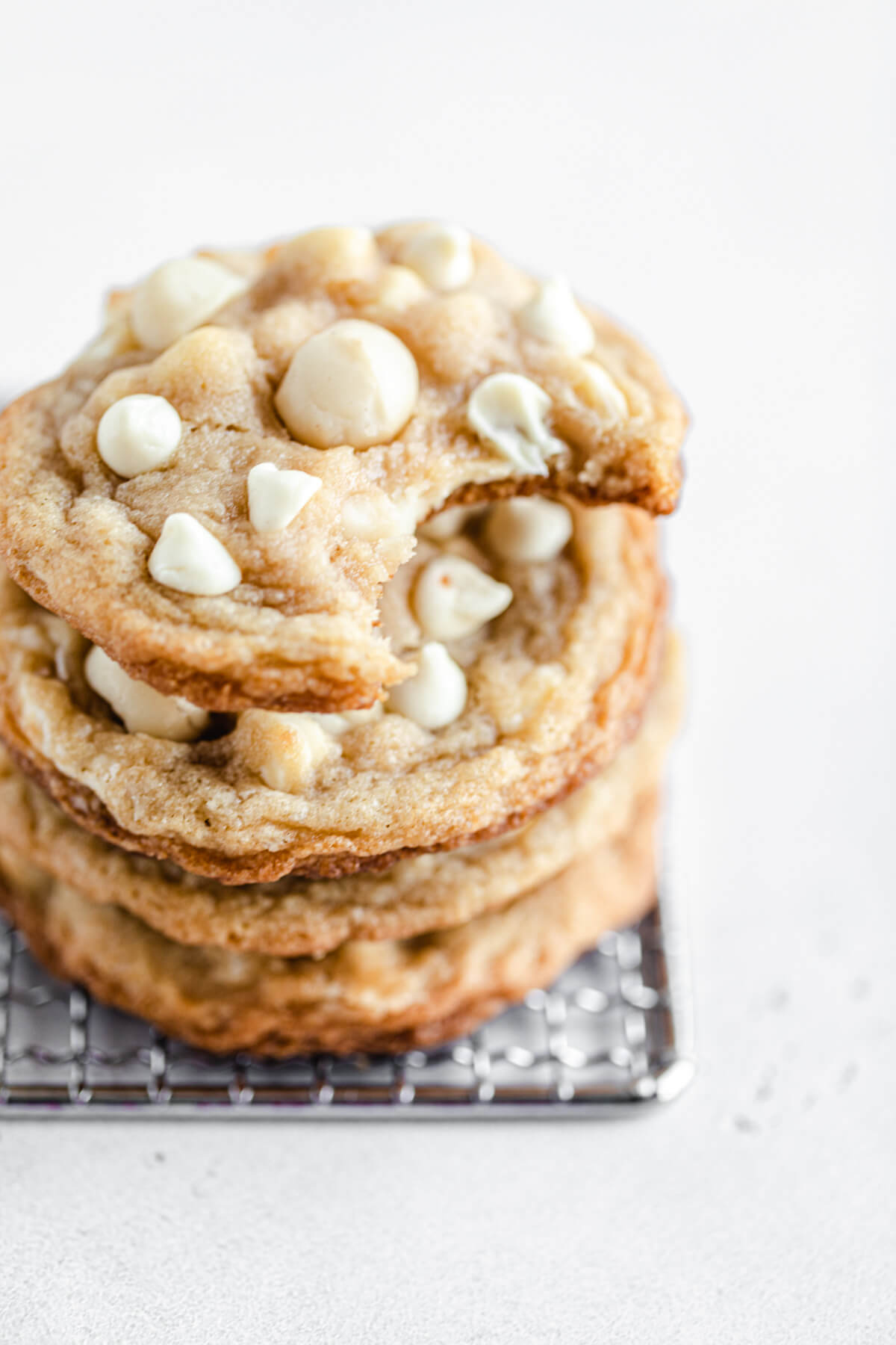 stack of cookies with a bite taken out of the top one