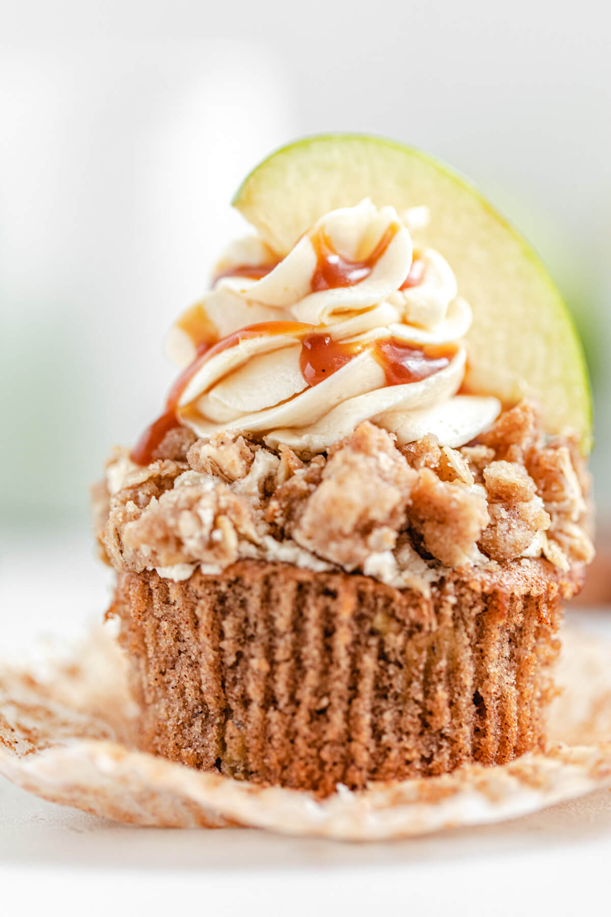 close up of unwrapped apple crumble cupcake