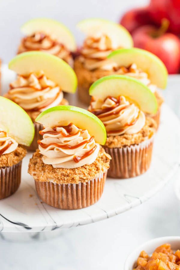 cinnamon apple cupcakes filled with homemade apple filling and topped with salted caramel cream cheese frosting and crumble topping Pinterest image