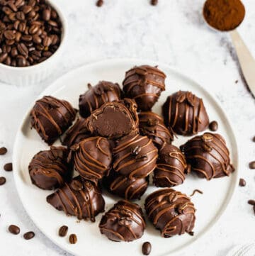 coffee ganache truffles coated in dark chocolate and drizzled with milk chocolate and whole coffee beans