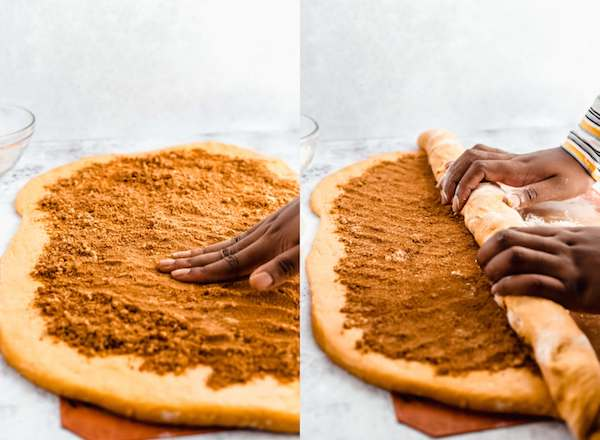 patting down brown sugar filling and rolling pumpkin cinnamon rolls
