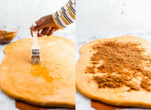 spreading melted butter and sprinkling on cinnamon brown sugar onto pumpkin dough