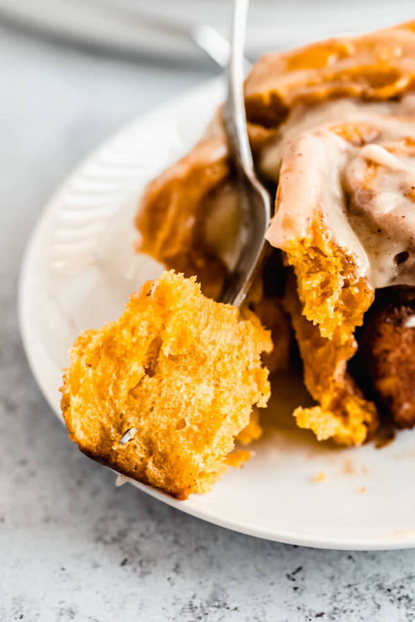 pumpkin cinnamon rolls topped with browned butter cream cheese icing