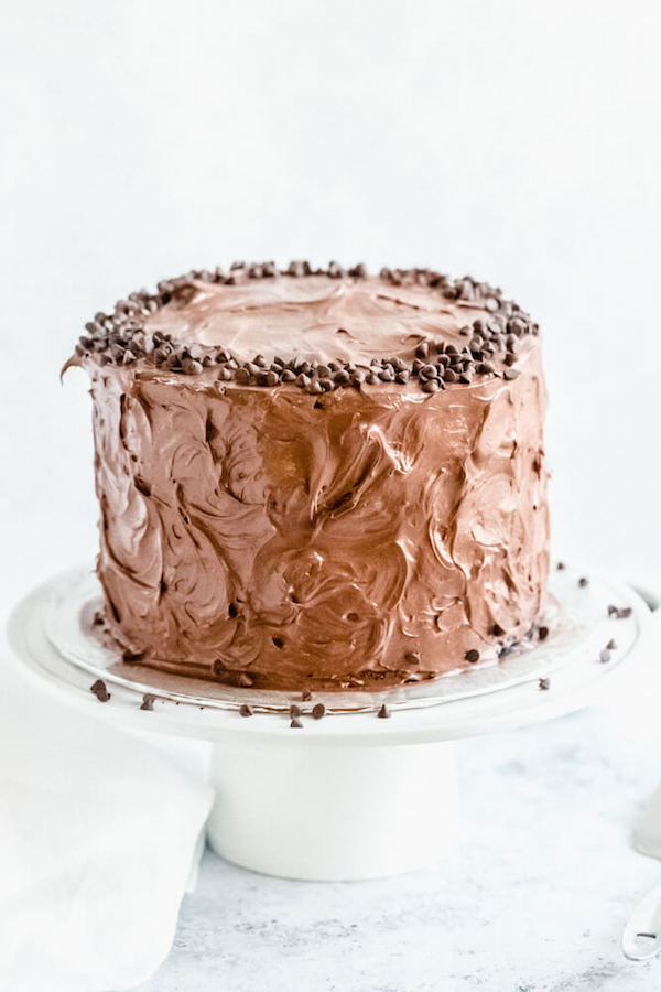 chocolate fudge cake on a cake stand