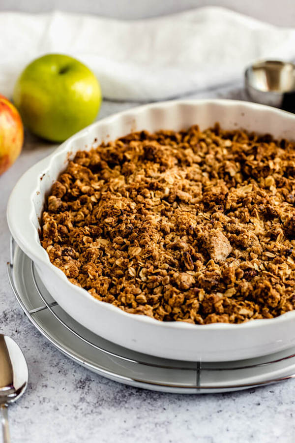 baked apple crisp on a round wire rack