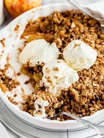 apple crisp topped with vanilla ice cream