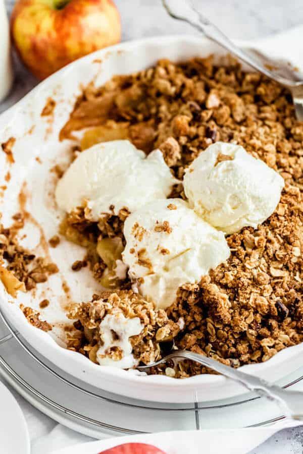 apple crisp topped with vanilla ice cream