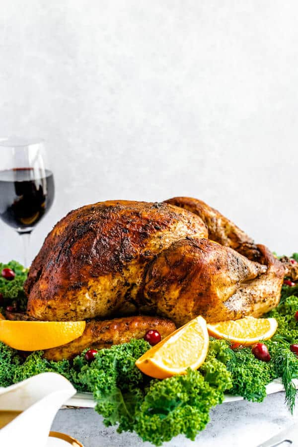 roasted turkey on a decorative turkey platter