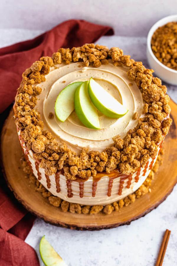 top view of apple crumble cake with crumble around the edges and apple slices in the centre