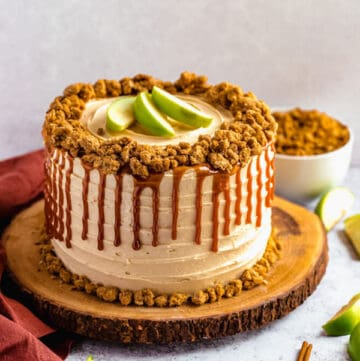 caramel apple crumble cake on a wooden cake stand