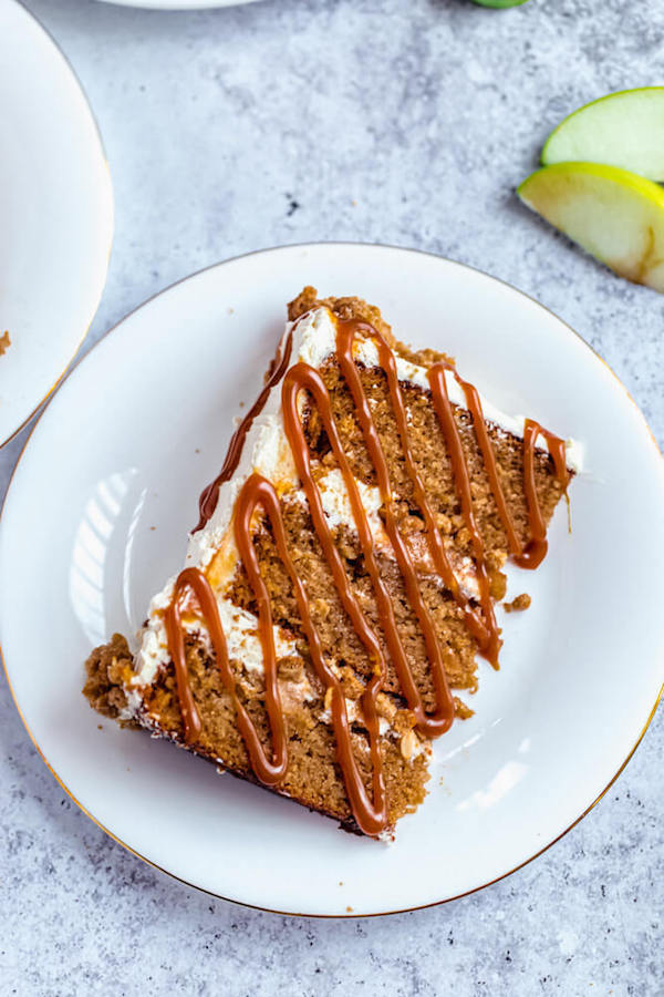 slice of apple crumble cake with salted caramel sauce drizzle