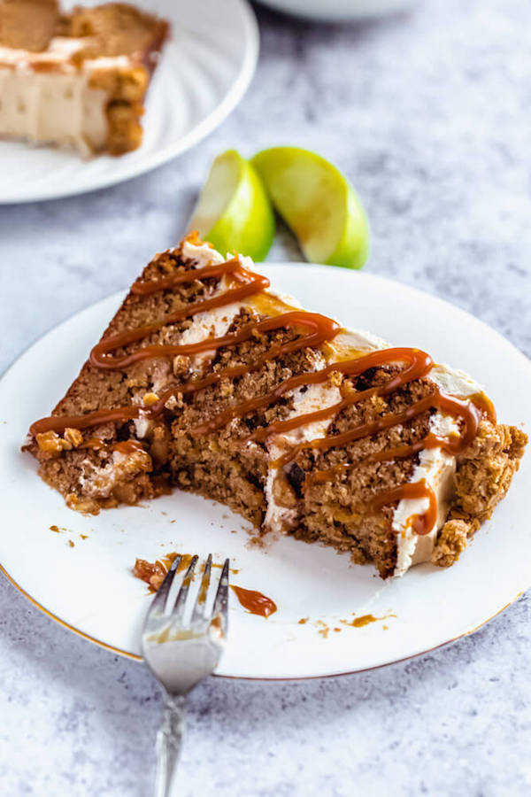 half eaten slice of caramel apple crumble cake on a plate