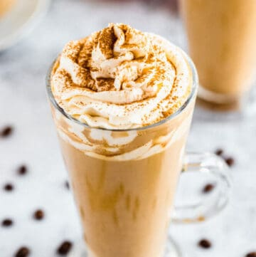 homemade pumpkin spice latte topped with whipped cream and a dust of cinnamon