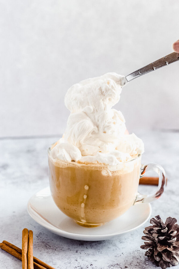 homemade pumpkin spice latte topped with whipped cream