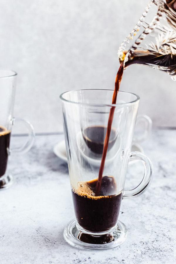 pouring espresso into glass