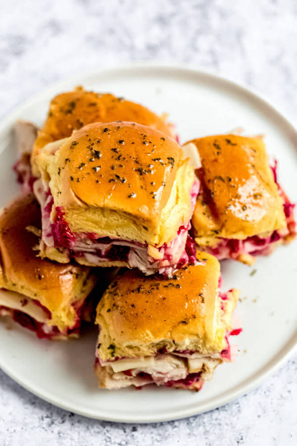 stack of turkey cranberry sliders on a plate