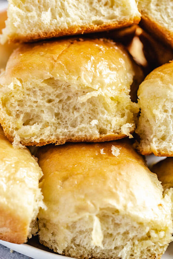 close up of dinner rolls stacked on a plate