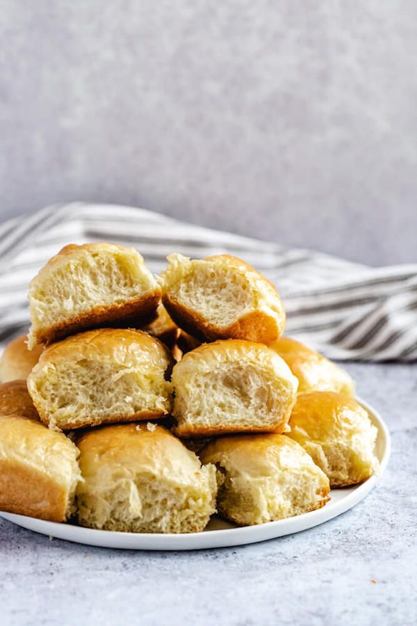 dinner rolls stacked on a plate