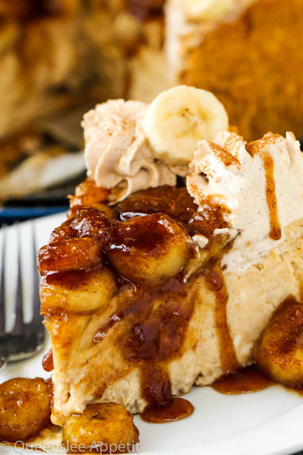 slice of banana cheesecake topped with bananas foster