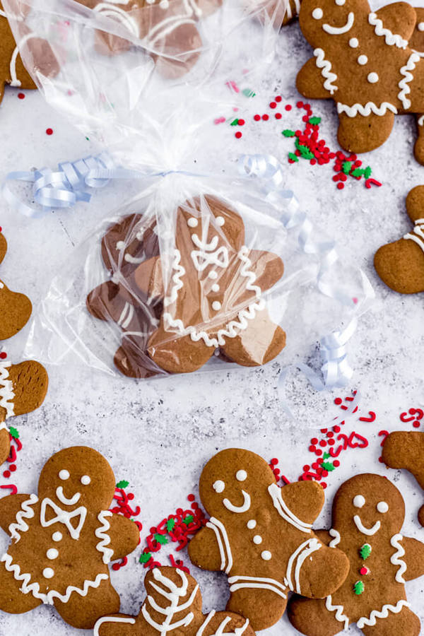 gingerbread man cookies wrapped in a treat bag with blue ribbon