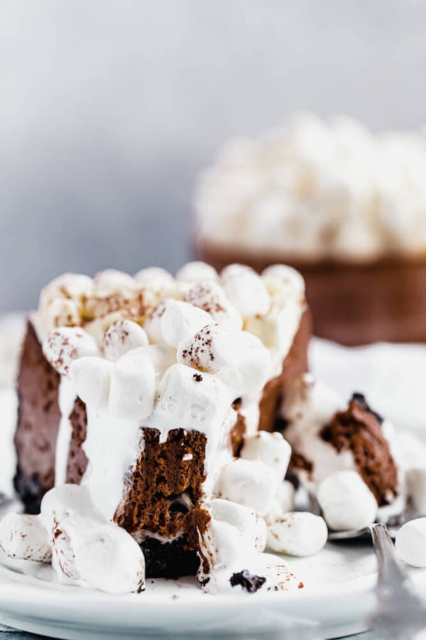 slice of marshmallow topped chocolate cheesecake with bite taken out