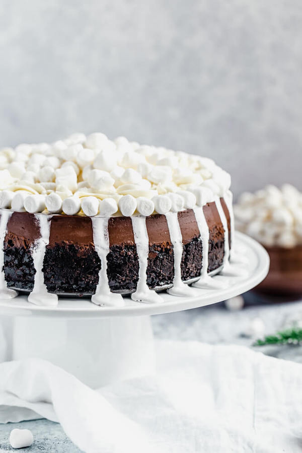 side of chocolate marshmallow cheesecake with marshmallow drip and topping