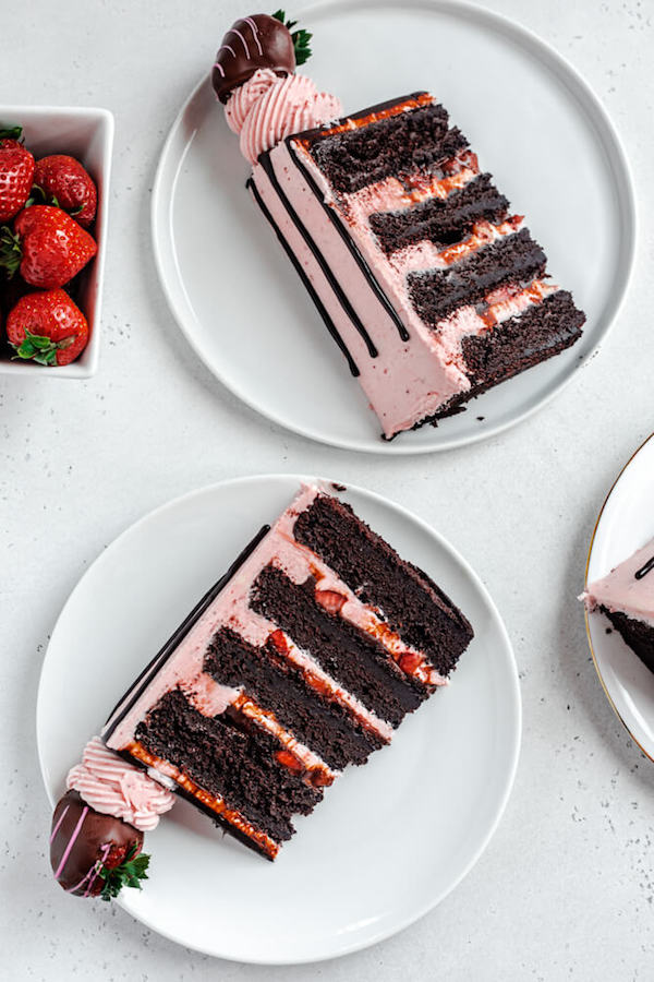 two slices of cake on white plates