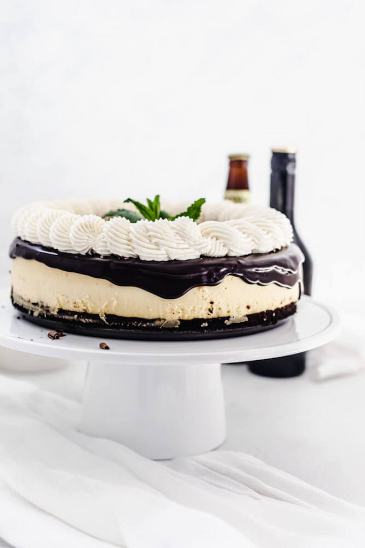 cheesecake on a white cake stand
