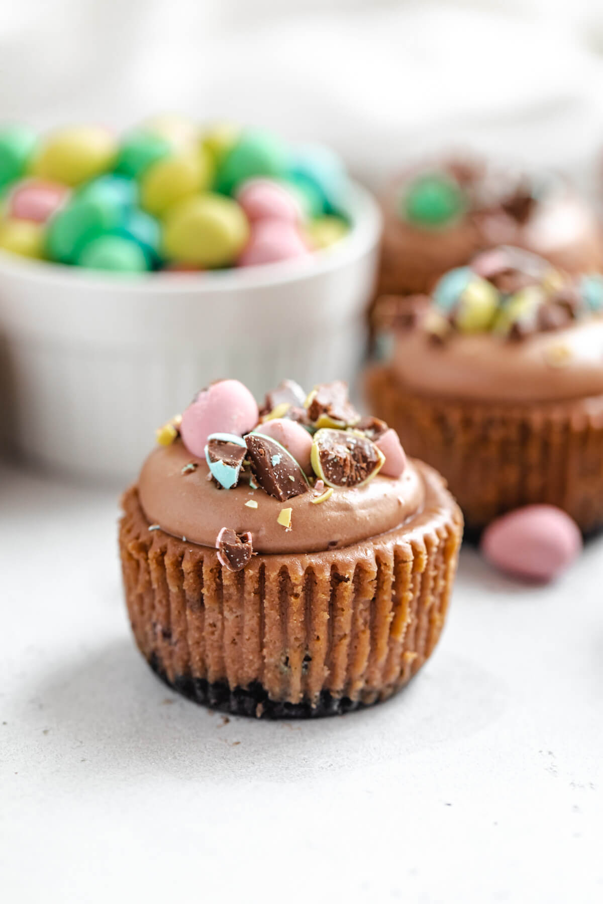 close up of cheesecake cupcake with chocolate Easter eggs in a ramekin