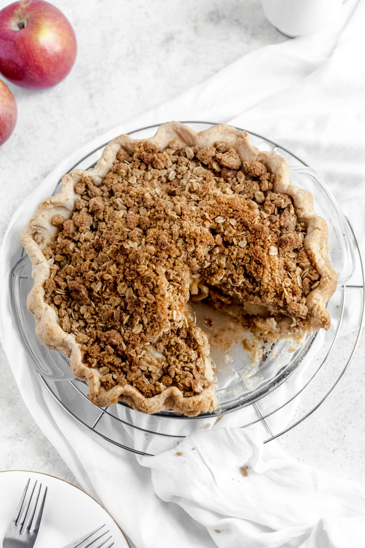 crumble topped apple pie with a slice taken out