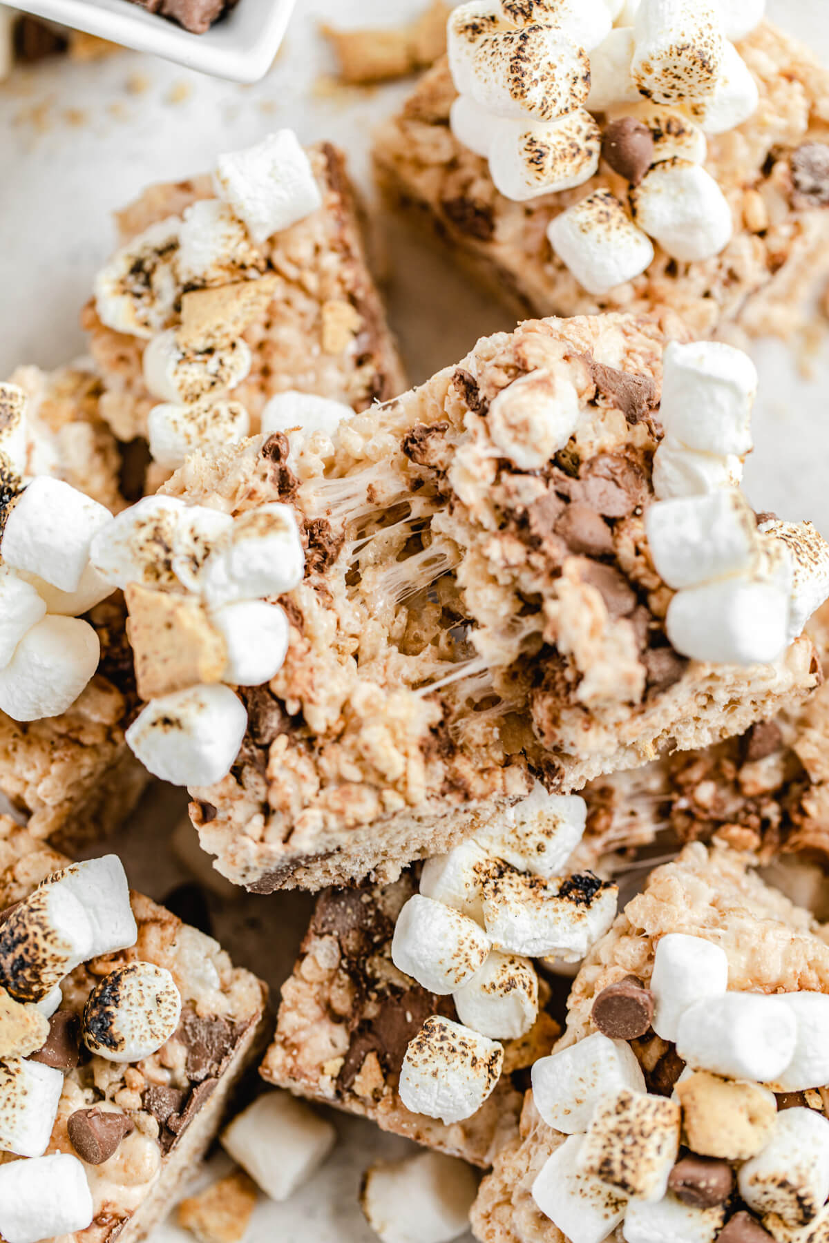 gooey marshmallow between Rice Krispie bar broken in half