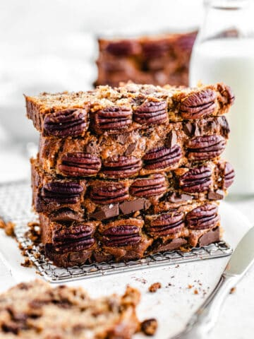 stack of four slices of banana bread, with pecans on the front