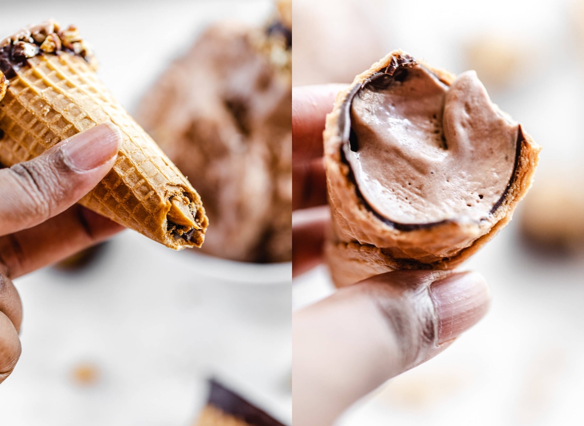 holding half eaten chocolate and peanut butter cones