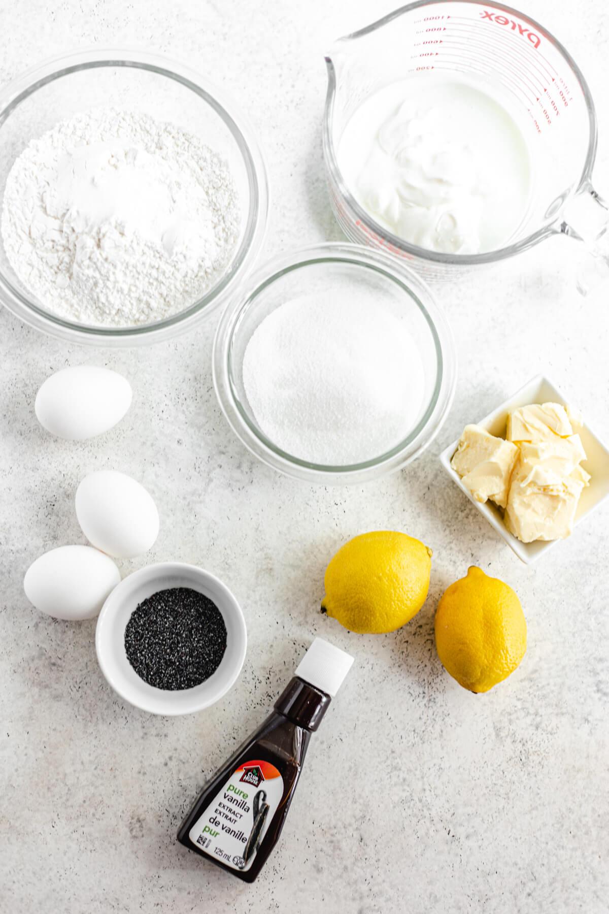 3 eggs, 2 lemons, butter, vanilla, sugar, flour, poppy seeds and buttermilk ingredients
