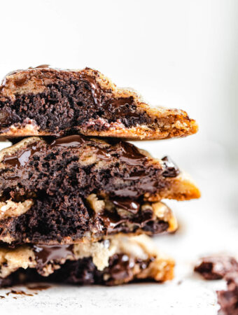 stack of halved brownie stuffed chocolate chip cookies