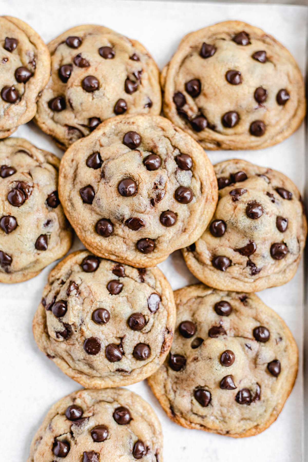 cookies piled together on a baking sheet