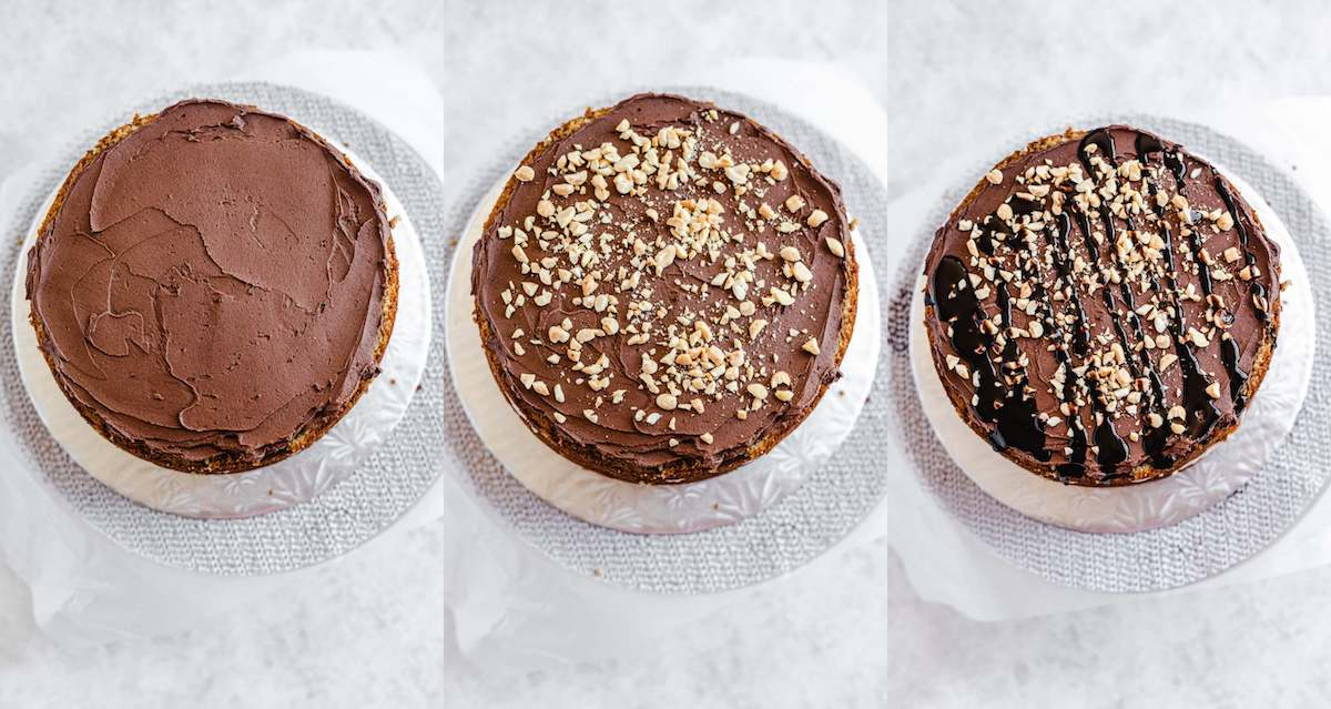 chocolate frosting, peanuts and chocolate sauce on a cake layer
