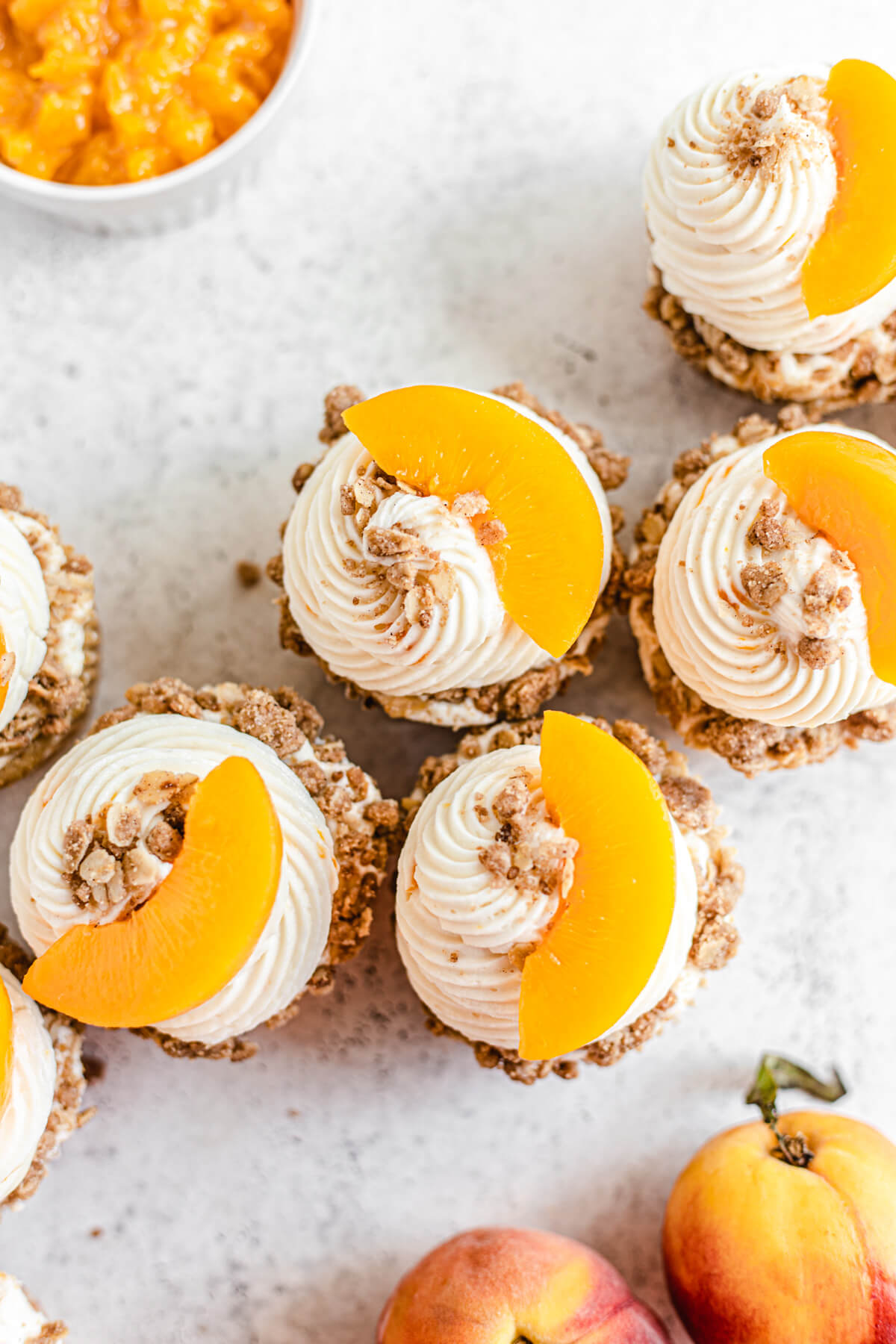 top view of cupcakes topped with crumble and sliced peaches