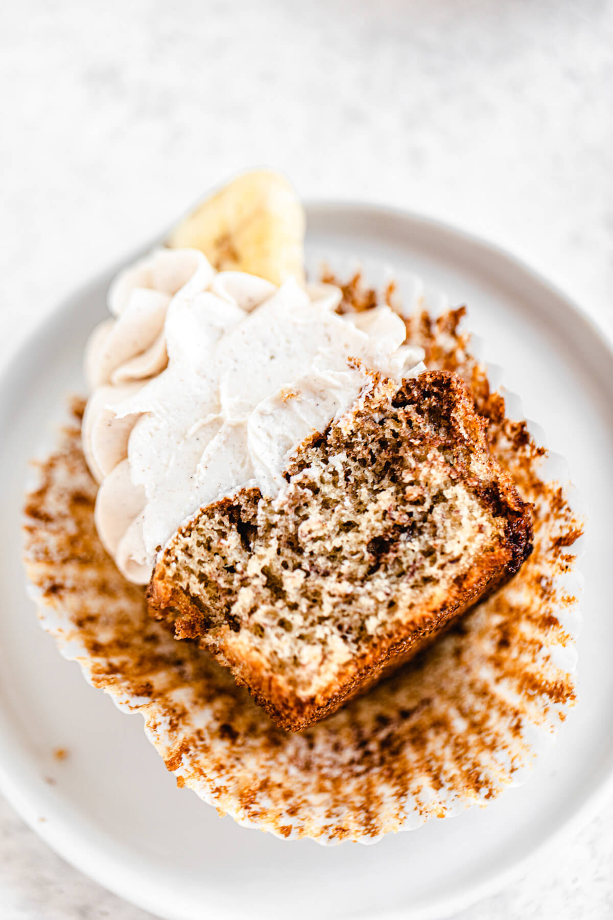 halved cinnamon swirl cupcake laying in a white appetizer plate
